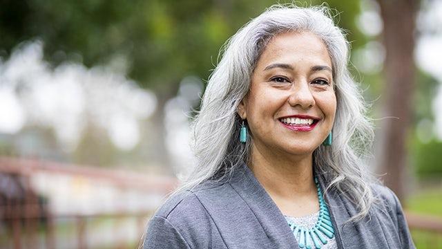Latino woman representing Siemens Amigos community