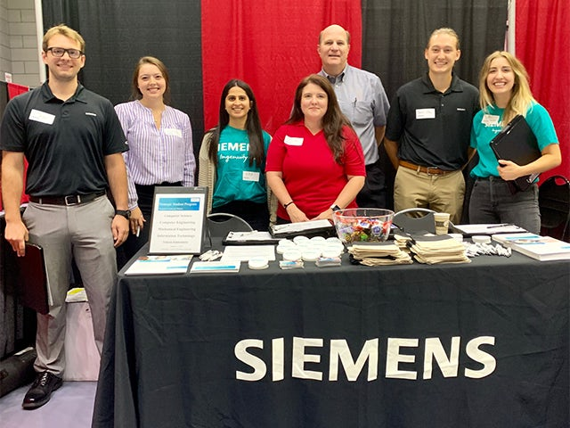 Siemens employees and university relations team at a job fair for recent graduates and interns