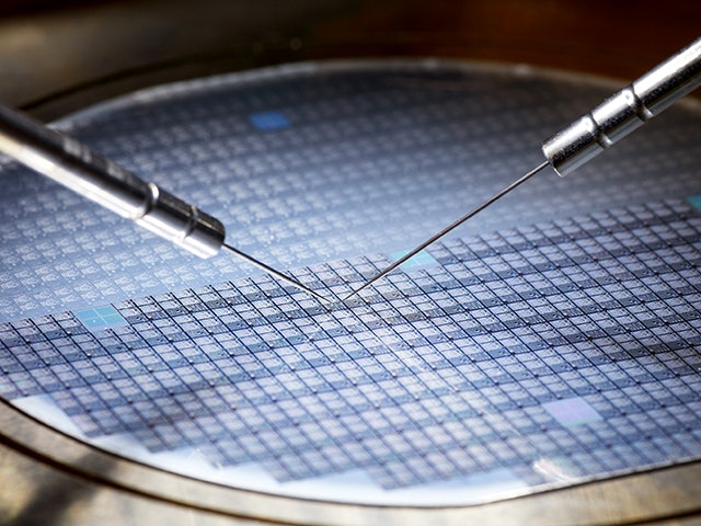 Two probes touching a wafer | The Calibre YieldAnalyzer tool examines a layout and scores the design for both critical area analysis and manufacturability.