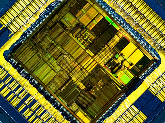Close up look at an IC Chip that our IC Design, Verification & Manufacturing tools helped to create.