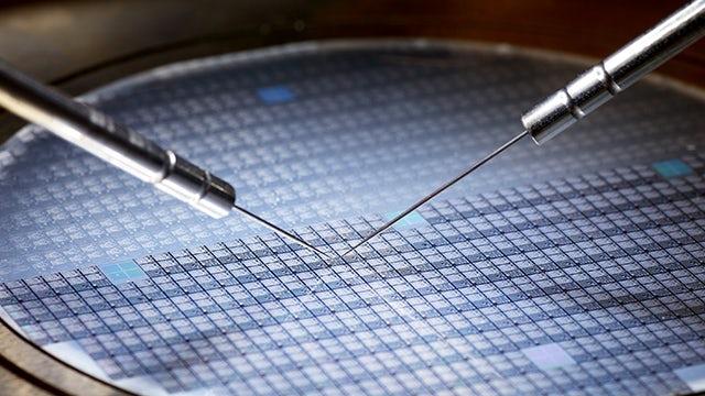 Calibre YieldAnalyzer / test probes touching a wafer
