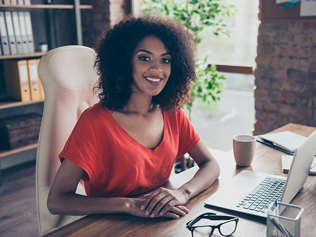 Woman working from home smiling