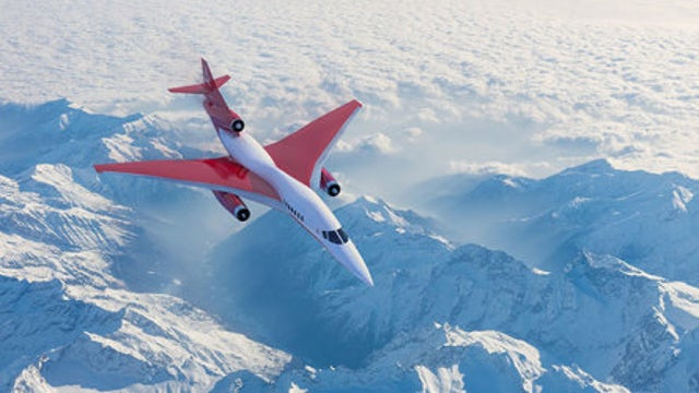 Jet flying over snow-covered mountains